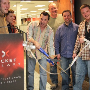 Don cutting the ribbon at the opening of Ticket Galaxy.